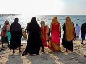women at beach in kochi, kerala, india