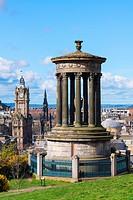 View of Dugald Stewart monument on Calton Hill and skyline in Edinburgh, Scotland.