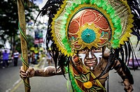 """Participants of the parade during the celebration of Dinagyang in homage to """"""""The Santo Niño"""""""", the patron saint of many Philippino cities."""