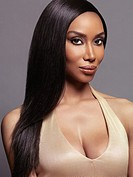 Beauty portrait of black african american woman with long straight hair isolated on gray background.