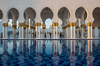 United Arab Emirates - Reflection of arches on water of Sheikh Zayed Mosque in Abu Dhabi.