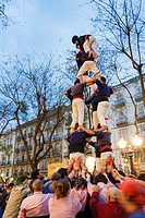 Little boy climbs to top to complete the human tower being created during festival day of Sant Jordi (April 23) in Tarragona, Catalonia, Spain.