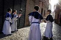 """Group of """"""""monaguillos"""""""" during a break playing with the baskets they use during the processions. Monaguillos are the boys who accompany the images."""