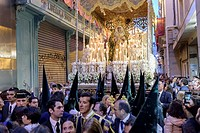During the Easter week, processions with the image of Christ and the virgin Mary parade around Seville. Monaguillos priest, police and penitents march...