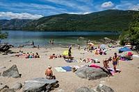 Bathers on Cañales Beach. Natural Park of the Lake of Sanabria. Zamora. Castilla y León. Spain.