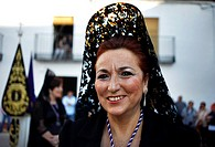 A woman wearing a mantilla miles during Easter Week celebrations in Baeza, Jaen Province, Andalusia, Spain.