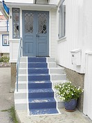 Blue painted stair carpet on traditional wooden house in coastal conservation area near Gothenburg, Sweden.