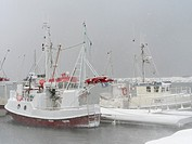 Harbour during winter storm with fishing boats. Village Ramberg on the island Flakstadoya. The Lofoten Islands in northern Norway during winter. Europ...
