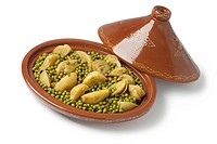 Traditional Moroccan oval tagine with meat, peas and fennel on white background.