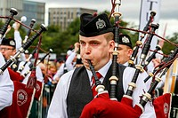 Piper from the St Laurence O'Toole pipe band from Dublin, playing at Piping Live championships Glasgow Scotland.