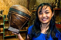 Tingkop basket held by young woman at Tagbanwa tribal village souvenir shop, Butterfly Garden, Puerto Princesa, Philippines