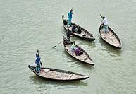 Rowboats on the Buriganga River, Dhaka, Bangladesh.