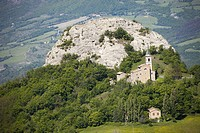 Italy, country with church and hill.