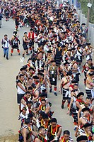Naga tribesmen participating at the Stone pulling ceremony during Kisima Nagaland Hornbill festival, Kohima, Nagaland, India.