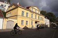 Silhouettes of a couple riding on bikes in the streets of the old town,Tallinn, Estonia, Baltic States, Europe.