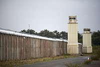 razor topped walls and watchtowers of the former maze prison long kesh site northern ireland.