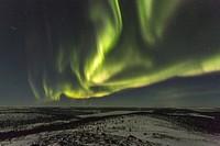 Northern light, Aurora borealis over winter landscape, Gällivare, Swedish Lapland, Sweden.