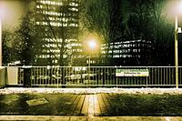 Residential buildings and street lights in a cold winter night. Berlin, Germany