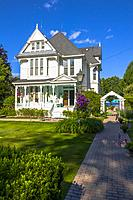 Historic old white Victorian house home.