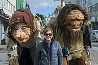 Woman (Model Release 20020923-10) posing with trolls in the city center of Akureyri, northern Iceland.