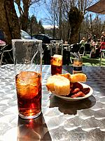 Two glasses of vermouth and tapa in a terrace. Spain.