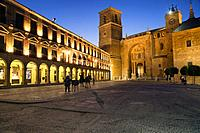 Town hall on left and San Andres Apostol church in front, Don Quixote and Sancho Panza statues in front of town hall, Plaza Mayor, Villanueva de los I...