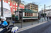 Vintage tram on a Batalha Square in Porto city on Iberian Peninsula, second largest city in Portugal. NH Collection Hotel on background.