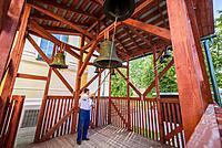 Man ringing the bell of Cathedral of Beheading of Ioanna Predtechi, Zaraysk kremlin, Moscow Region (Russia).