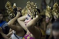 A group of female Logong dancers getting ready at the backstage before the show in Ubud, Bali, Indonesia.