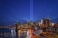 911 Tribute In Light In NYC - View to the Brooklyn Bridge, the FDR highway and the Financial District during the Tribute In Light memorial. Seen are t...