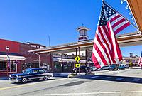 American flag with covered crosswalk in background on Cottage Ave in downtown area of Cashmere a city in Chelan County, Washington, United States.