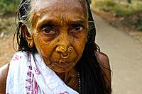 Hindu woman with turmeric powder on the face ( Odisha state, India). Turmeric powder is used in ayurvedic medicine to treat various diseases. She is a...
