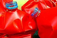 red plastic waste bottles