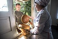 Workers of the Nikitin Kolkhoz bakery prepare bread, Ivanovka village, Azerbaijan. Bakery makes bread for local people. Children from school and kinde...