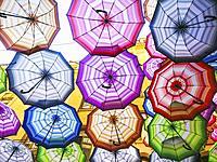 BUCHAREST, ROMANIA Colorful umbrellat outdoor restaurant, a symbol of Bucharest.