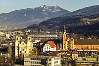Austria, Tyrol, Innsbruck, elevated view of the Wilten Basilica and the Wilten Abbey Church, sunset, winter.