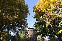 Seattle, Washington: Volunteer Park water tower with fall foliage.