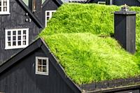 Wooden house with turf roof, Faroe Islands, Denmark.