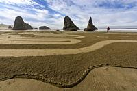 Sand labyrinth created by Labyrinth artist Denny Dyke at low tide on Bandon Beach, Bandon, Oregon, USA.