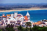 view for the old town of Lagos city with tower of Santo Antonio church, in far background long Meia Praia, Algarve, Portugal, Europe