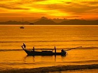 Longtail boat silohuette - Krabi, Thailand.