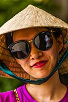 A Chinese tourist wearing a typical Vietnamese conical hat, Reunification Palace (formerly the Presidential Palace), Ho Chi Minh City (Saigon), Vietna...