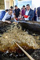 Men Serve PLOV (The National Dish) From A Large Cauldron At The Central Asian Plov Centre, Tashkent, Uzbekistan.