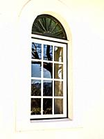 Closed window with an arch above. Cape Town, South Africa.