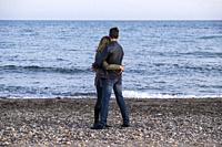 Couple in a warm embrace at the beach of Malaga, Spain, Europe.