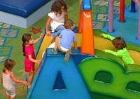 kids play at daycare center.