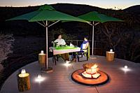 Romantic outdoor dining at Huab Under Canvas, Damaraland, Namibia, Africa.