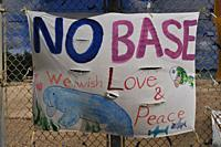 Henoko Bay, Okinawa, Japan: sign for peace along the fence of American Marines military base of Camp Schwab