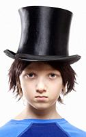 Boy with Brown Wig and Black Hat - Isolated on White.