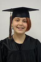 6th Grade Girl in Cap and Gown, Wellsville, New York, USA.